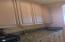 EXTRA SPACE AND CABINETRY OFF THE KITCHEN CAN BE USED FOR LOTS OF EXTRAS!
