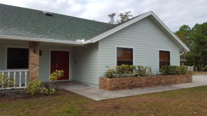 Completely renovated front with covered patio