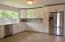 Everything is NEW in this large spacious kitchen, soft close cabinets, pantry, SS Appliances, quartz counters, tile backsplash