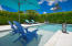 The saltwater pool is surrounded by a 6' hedge for privacy or which may be trimmed for expansive golf views and lake views.