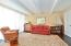 Generous French doors open to the second BR which converts to a home office or cozy den
