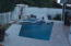 Travertine pool deck electric screen opens screen room to the pool area.