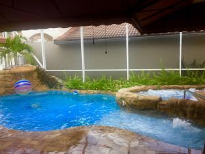 Enjoy this custom made rock garden pool all year round. Don't worry about those chilly cold fronts, you'll splash around comfortably due to the luxury of solar panels heating this pool up to 105°. Sit back, relax, and enjoy watching the steam rise from the pool on those chilly days and nights!