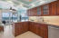Modern maple cabinetry with slide outs, thick granite counters