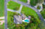 Aerial view of home on corner lot with pool in the backyard.