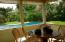 Enjoy the view of the pool from your enclosed porch