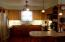 Stainless appliances/oak cabinetry.