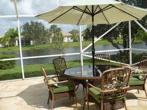 BACK PATIO WITH LAKEFRONT AND DECORATIVE TILE