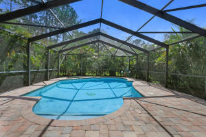 26'x16' Paver deck pool w/ oversized Dade Co approved structural screen supporting beams.