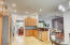 WOOD OAK CABINETS AND RICH GRAITE COUNTERTOPS