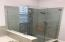 FRAMELESS SHOWER ENCLOSURE WITH BEAUTIFUL GLASS TILE SURROUND