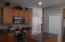 Kitchen with Upgraded Stainless Steel Appliances, Granite Countertops, Island