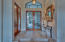 Foyer with tasteful glass and wrought iron doors