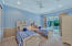 Guest bedroom with designer accents and courtyard/pool access.