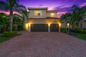 Five bedroom single family home for sale in beautiful gated community of Paloma in Palm Beach Gardens.