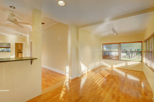 Beautiful wood floors and many windows make this front porch light and bright.