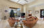 Livingroom featuring luxurious marble floors with 20 foot ceilings