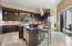 Chefs kitchen - custom cabinets, top of line appliances, breakfast bar, wine cooler