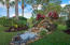 elegant landscaping with waterfall feature and landscaping lighting