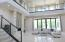 Living/entertaining spaces connect to the loggia through spans of glass