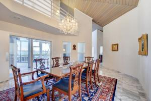 Wood ceiling nicely accents the Formal Dining Room with abundant natural light on 1st and 2nd floor.