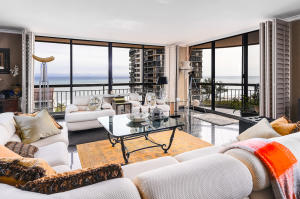Living area with Full Ocean views with a wrap around Balcony