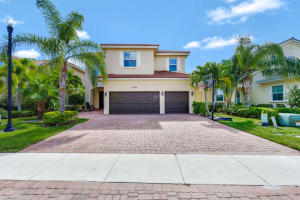 3 car garage, five bedroom single family home for sale in beautiful gated community of Paloma in Palm Beach Gardens.