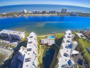 The 2 buildings jut out to the Intracoastal with the pool and clubhouse in the center. Aerial of Jupiter Island and the Ocean.