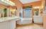 Dual vanities, sauna tub, walk in shower