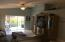 Living Room with sliders off the back that has a relaxing screened patio