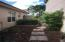 Side yard has large pavered walkway