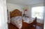 2nd bedroom upstairs has wood laminate floor, walk-in closet and its own full bathroom.