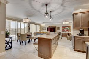 Large great room including brand new kitchen island with Caesarstone counters, custom lighting & Italian tile flooring, designer ceiling fans and fabric drum shades througout . List price includes all furniture minus a few select pieces. No artwork included in sale.