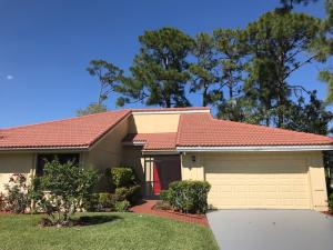This very attractive home is located on the golf course with a view of golf course and lake.