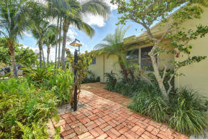 Lush Tropical setting with charming accent of Old Chicago Brick as your walk way!. Seaside cottage feel in the heart of the Village of Tequesta. Walking distance to Constitution Park.