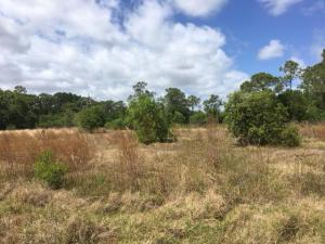 On paved road in heart of Jupiter Farms, 9.6 acres