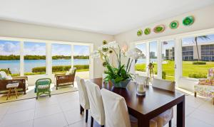 Dining area with wide angle views of the crystal clear blue water