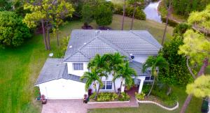 171 COCOPLUM LANE 4BR/3BA -MASTER/W SITTING RM OPTION &VERANDA ON 1/2 ACRE CANAL,PRESERVE LOT