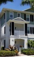 3-Story End Unit Townhome. This view shows the front with the second story master bedroom's private balcony above the porch.