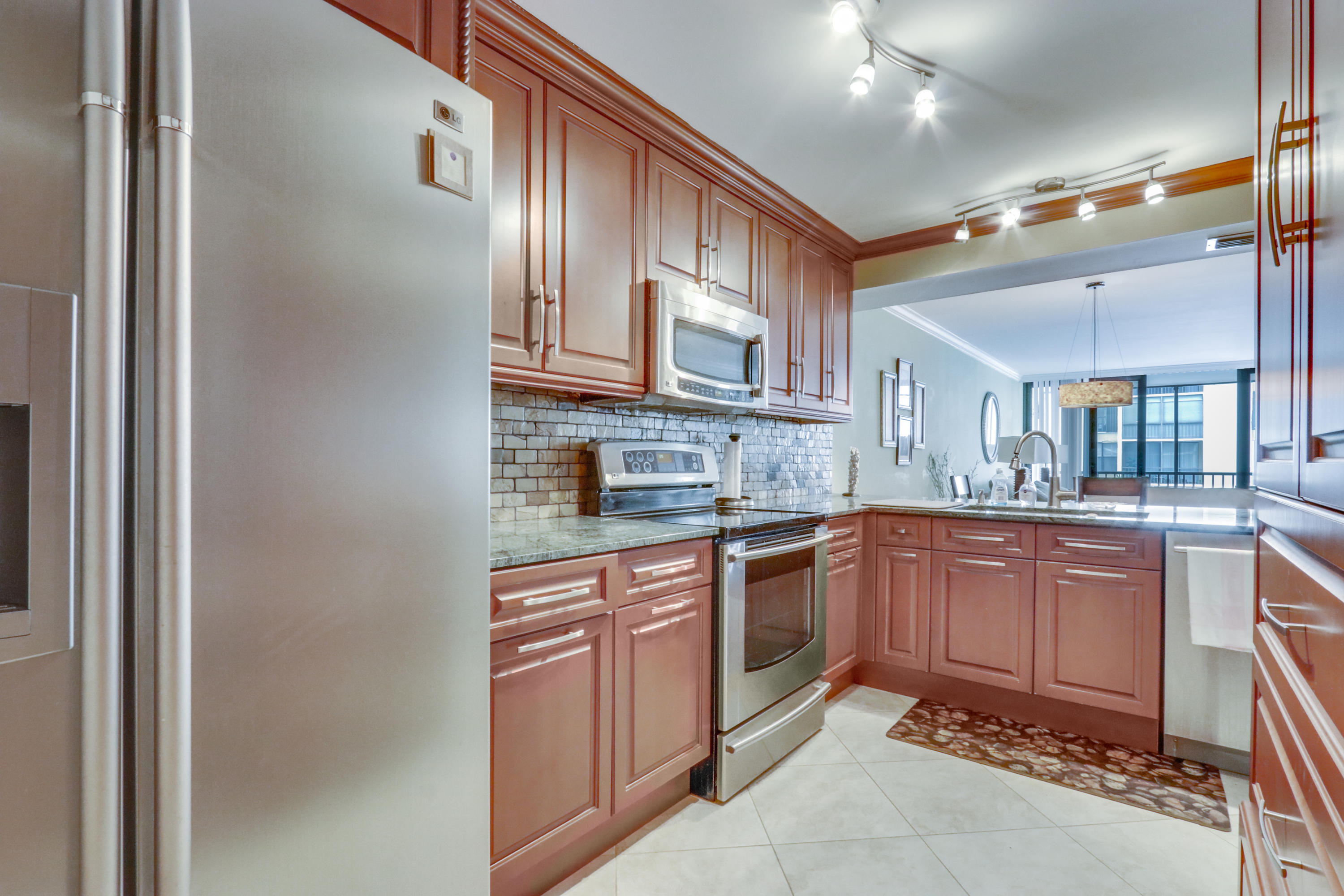 It is rare to find an updated waterfront 2/2 condo with Intracoastal views in the beautiful community of Boca Bayou. Gorgeous kitchen with wood cabinets, stone look back splash, stainless steel appliances, and granite counter tops. Updated bathrooms. Walk in closet with washer and dryer so no need to save your quarters! Kick back and relax while enjoying the views from your very own screened in balcony. Gated community features pools, gym, tennis, boat docks, BBQ areas, ocean access and more! Conveniently close to Mizner park, beaches, highways, shopping, dining and more! If you don't take a look at this home soon, there's a good chance that another Buyer will make an offer, & you'll probably spend weeks locked in your bedroom crying over it. Schedule a showing ASAP...you'll be glad u did! *** The special assessment (which has not been billed to the owners yet) for 8-206 is estimated to be $29,917.78. The special assessment will be billed to the owners 90 days after the construction project is complete. Which is estimated to be late 2019 or early 2020. ***The Seller Has Agreed to Pay Full Assessment***