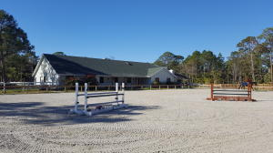 "Marvelous equestrian property with French cottage style large house and ""all weather"" riding ring."