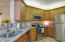 Honey maple wood with chocolate glaze cabinets, granite tops & stainless steel appliance.