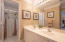 Full bathroom connecting two bedrooms