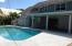 Beautiful pool, covered patio and tiki hut over looking your dock!