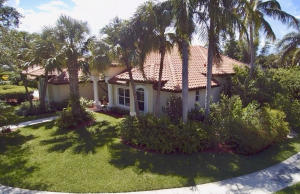 Canopy tree lined street with sidewalks just across the street from Tequesta Country Club.