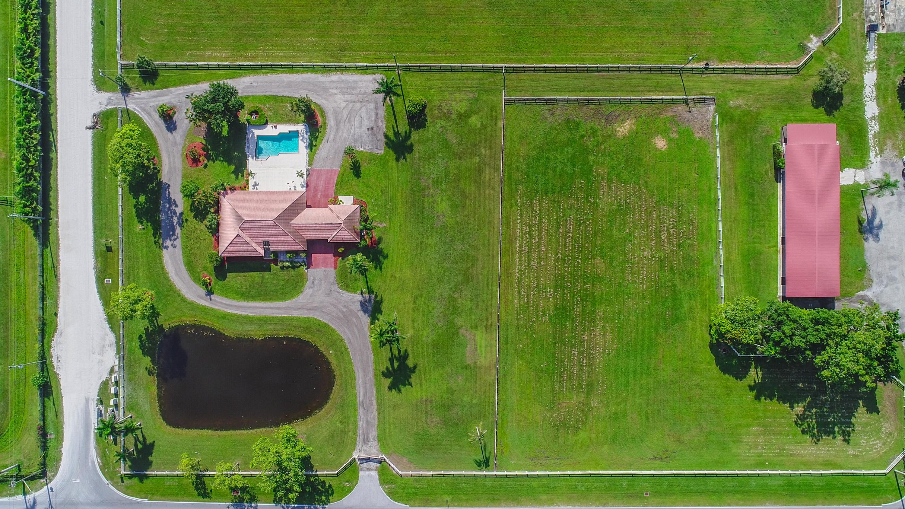 4560 South Shore Boulevard, Wellington, Florida 33414, 5 Bedrooms Bedrooms, ,4 BathroomsBathrooms,Single Family,For Sale,South Shore,RX-10444555