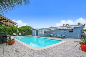 Beautiful New Pavers surround this huge pool with a Tiki Hut for entertaining!