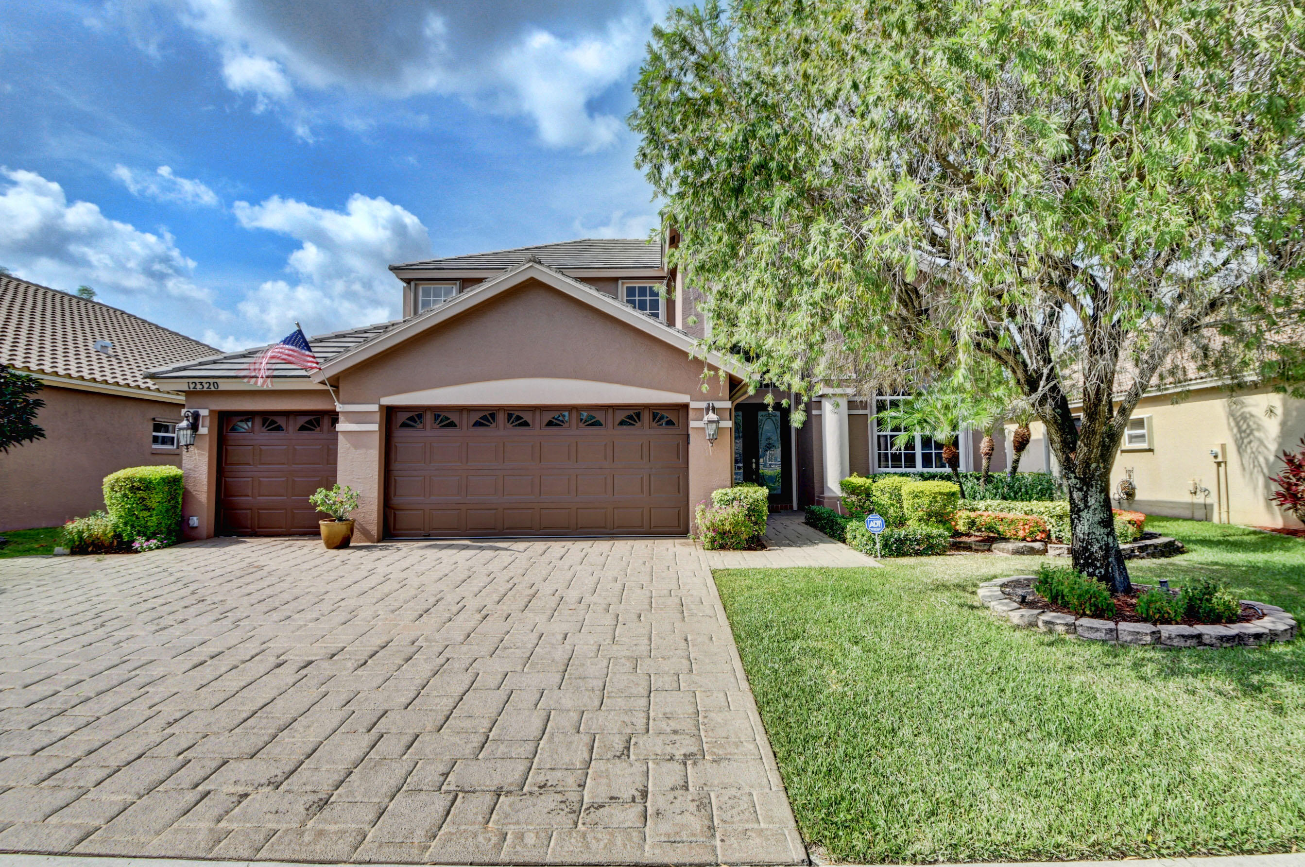 STUNNING custom home boasts an oversized screened pool area with expansive entertaining space overlooking spectactular lake views. This home features one bedroom ensuite on 1st floor with Master and 2 bedrooms upstairs.  Additionally features a large kitchen with granite tile and stainless appliances,  central vac system, UV lighting in both AC units, T.V. mounting systems and a 3 car garage with an extended driveway for added parking.  Come see the communities newly renovated clubhouse, a resort-style olympic size pool, a kiddie pool, playground, a state-of-the art fitness center, six tennis courts, a basketball court, and much more
