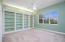 Upstairs large bedroom with view of lake and built in book shelves