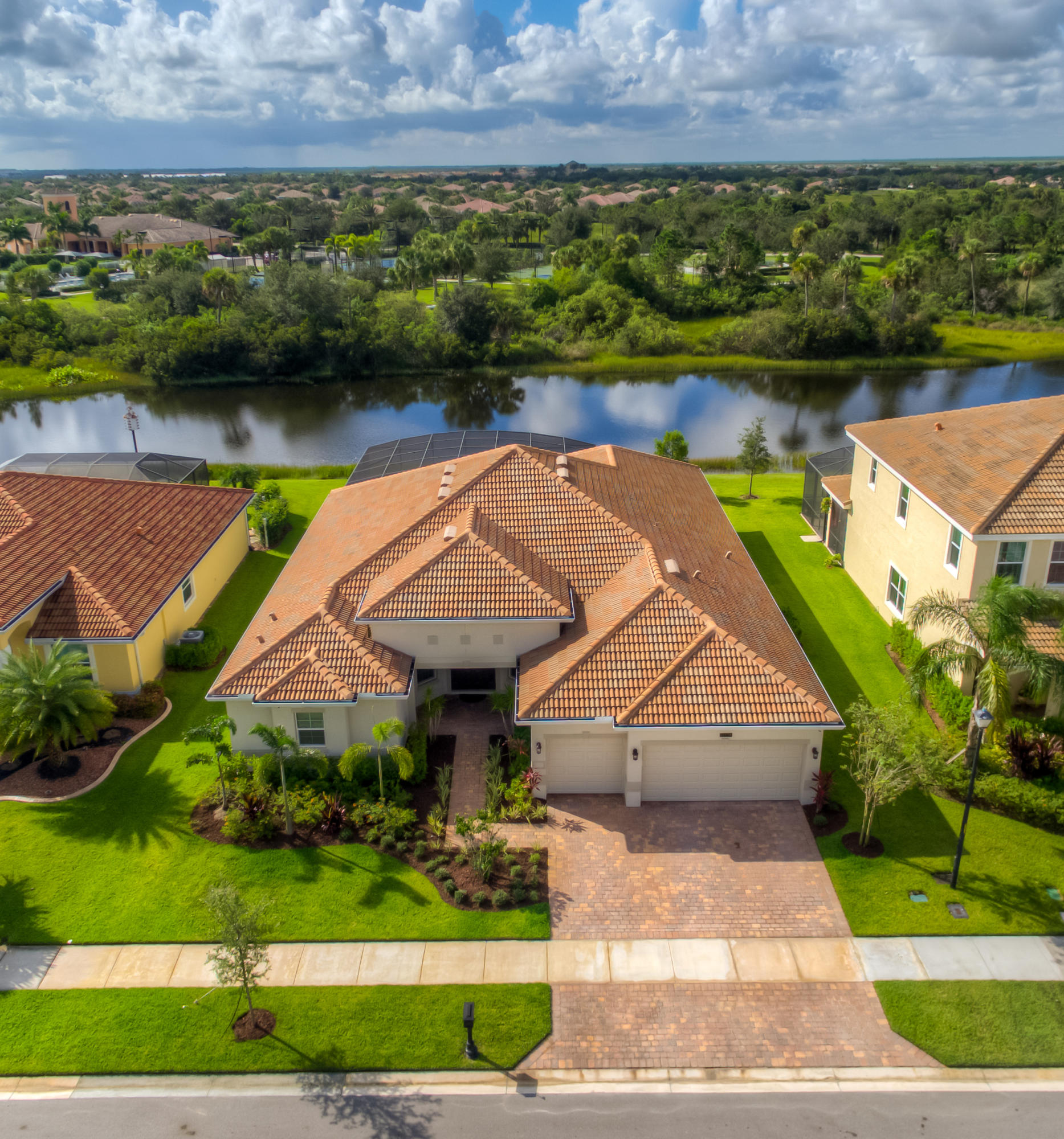 Wow! This 2016 D.R. Horton-built estate pool home is loaded with gorgeous, modern amenities. First take notice of its ideal location that is within walking distance to the community pool, yet still offers a secluded, private, and quiet preserve/lake view. A predominantly North/South orientation allows the most daily light exposure to soak up the warm Florida sun while relaxing poolside. Inside, countless upgrades have taken this home above all others. The open and inviting floorplan is perfect for entertaining yet still has 5 spacious bedrooms.  Decorative crown, base, window, and door moldings have been added and enhanced throughout. Interior painting, new lighting fixtures, fans, and decor were carefully selected to coordinate beautifully. (click link to read more) Wow! This 2016 D.R. Horton-built estate pool home is loaded with gorgeous, modern amenities. First take notice of its ideal location that is within walking distance to the community pool, yet still offers a secluded, private, and quiet preserve/lake view. A predominantly North/South orientation allows the most daily light exposure to soak up the warm Florida sun while relaxing poolside.  Inside, countless upgrades have taken this home above all others. The open and inviting floorplan is perfect for entertaining yet still has 5 spacious bedrooms.  Decorative crown, base, window, and door moldings have been added and enhanced throughout. Interior painting, new lighting fixtures, fans, and décor were carefully selected to coordinate beautifully.  An elegant dark wood kitchen boasts a ton of room for gathering or cooking with a Frigidaire Professional Stainless Steel appliances package. Santa Cecelia granite countertops, a central island, tile backsplash, and under cabinet, recessed, and pendant lighting make the kitchen a focal point. A wet-bar is centrally located for easy access and entertaining as well. The 2 front guest rooms share a bathroom with dual sinks and granite top. All of the 3 bathrooms' fix